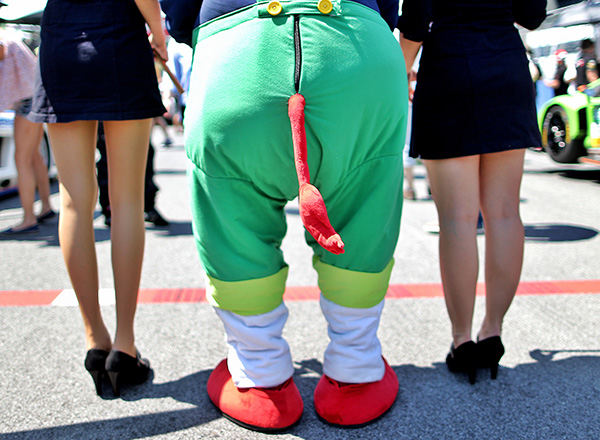 SPIELBERG,AUSTRIA,06.JUN.15 - MOTORSPORTS - ADAC GT Masters, Red Bull Ring. Image shows the back of girls and a mascot. Photo: GEPA pictures/ Markus Oberlaender
